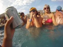 Competitive blindfolded wrestling for beer cans, San Juan del Sur, Nicaragua